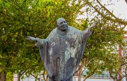 Statue of priest in Alchochete Portugal. Picture taken on a sunny day to a statue of a priest in Alcochete Portugal Stock Image