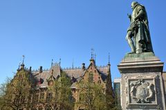 The Statue of Prince William the first, designed by Louis Royer and unveiled in 1848, with the old Ministry of Justice. In the background. Located on Plein royalty free stock images