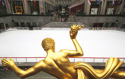 Statue of Prometheus and ice-skating rink at the Lower Plaza of Rockefeller Center Royalty Free Stock Photo