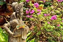 Statue in Pura Tanah Lot  with offerings, Bali Royalty Free Stock Image