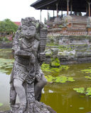 Statue at Puri Agung Semarapura Justice Court Bali. One of many statues surrounding the lily pond at Puri Agung Semarapura in Bali, Indonesia royalty free stock image