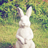 Statue of rabbit in the garden with retro filter Royalty Free Stock Photography