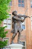 Statue of raftsman playing the violin in Torun Royalty Free Stock Image