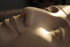 Statue of Ramesses lying down in museum in Memphis Stock Image