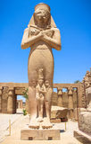 Statue of Ramses II with his daughter Merit-Amon in the temple of Amun-RA (the temple of Karnak in Luxor) Stock Images