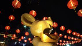 Statue rat with gold money and red lantern with firework display