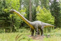 Statue of realistic Diplodocus dinosaur. In a wild forest Royalty Free Stock Photo