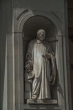 Statue 005. Recessed statue built into outside church wall in florence italy Stock Images
