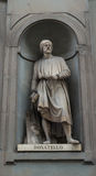 Statue 003. Recessed statue built into outside church wall in florence italy Royalty Free Stock Image
