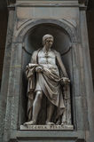 Statue 001. Recessed statue built into outside church wall in florence italy Royalty Free Stock Photo