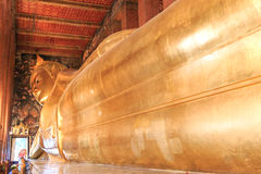 Statue of the Reclining Buddha inside the Wat Pho temple. Royalty Free Stock Photography