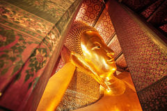Statue of the Reclining Buddha inside the Wat Pho temple. Stock Photography
