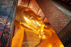 Statue of the Reclining Buddha inside the Wat Pho temple. Royalty Free Stock Photo