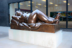 Statue of Reclining Woman  Fernando Botero in Vaduz.  is the capital  Liechtenstein.    a sculptor from Colombia 2. Vaduz, Liechtenstein - November 21, 2011 Royalty Free Stock Photography