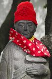 Statue with red cap and scarf royalty free stock image
