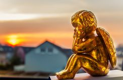 Angel watching the sunset. royalty free stock images