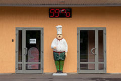 Statue of restaurant chefs. Entrance to the coffee shop. Stock Images