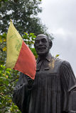 Statue of Reverend Dr. Ferdinand Kittel in Bangalore. Statue of Reverend Dr. Ferdinand Kittel stands in his own little park in Bengaluru. The yellow and red Royalty Free Stock Photo