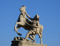 Statue with rider and horse. A staue with a rider which hold a horse Royalty Free Stock Image