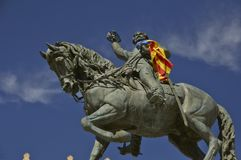 Statue of a rider on horseback in Reus. Statue of a horseman with sabre in hand, the flag Estelada on hand in Reus, Spain Stock Photo