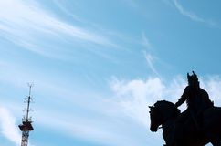 Statue of a rider standing on horseback in blue sky and sunshine Stock Photos