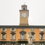 Statue of river Crostolo in Reggio Emilia, Italy. Statue of river Crostolo with Palazzo del Monte and the civic tower in the background in Reggio Emilia, Italy Royalty Free Stock Photos