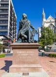 Statue of Robert Burns in Dunedin NZ. Statue of Robert Burns in Dunedin with St Pauls Cathedral in the background, Dunedin, New Zealand Royalty Free Stock Photos
