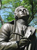 Statue of Scotish poet Robert Burns. Statue of poet and lyricist Robert Burns on the Literary Walk in Central Park, New York City royalty free stock photography