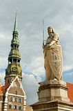 The statue of Roland and the Church of St. Peter in Riga, Latvia Royalty Free Stock Photo