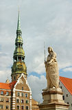 The statue of Roland and the Church of St. Peter in Riga, Latvia Stock Image