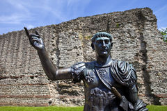 Statue of Roman Emperor Trajan and Remains of London Wall. A statue of Roman Emperor Trajan with remains of London Wall which was first built by the Romans in Royalty Free Stock Photography