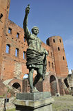 Statue of roman on front of roman gate in Turin. Northern Roman Gate in Turin, Piedmont province, Italy Stock Photography