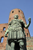 Statue of roman on front of roman gate in Turin. Northern Roman Gate in Turin, Piedmont province, Italy Stock Photos