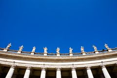 Statue in Rome. Famous colonnade of St. Peter's Basilica in Vatican, Rome, Italy Royalty Free Stock Images