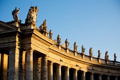 Statue in Rome. Famous colonnade of St. Peter's Basilica in Vatican, Rome, Italy Stock Image