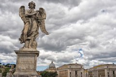 A statue on rome bridge Stock Photography
