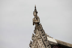 The statue on the roof. Of a Buddhist temple Stock Photography