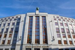 Statue on roof of entrance to the bank Czech National Bank. Royalty Free Stock Photography