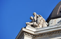 Statue on the roof. Manitoba Legislative Building in Winnipeg This photo was taken in Winnipeg City, Manitoba Province, Canada Royalty Free Stock Images