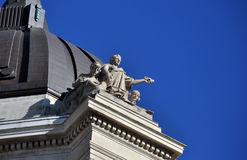 Statue on the roof. Manitoba Legislative Building in Winnipeg This photo was taken in Winnipeg City, Manitoba Province, Canada royalty free stock photo