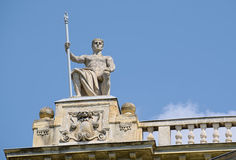 Statue on roof of Museum of Ethnography in Budapest, Hungary. BUDAPEST, HUNGARY - JUNE 14, 2016: Statue on roof of Museum of Ethnography in Budapest, Hungary Stock Photo
