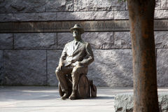Statue of Roosevelt in wheelchair. Distant telephoto shot of the statue of President Roosevelt in a wheelchair in Washington DC Stock Photo