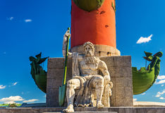 Statue at a Rostral column in Saint Petersburg Royalty Free Stock Photos