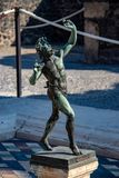 A Statue Among the Ruins of Pompeii royalty free stock photo