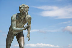 A statue of 'The Runner' in the garden of Achilleion in Corfu. Royalty Free Stock Images