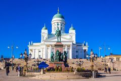 Statue of Russian czar Alexander II against Cathedral on Senate Square, Helsinki, Finland royalty free stock photo