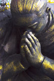The statue`s hands worship. Stock Photography