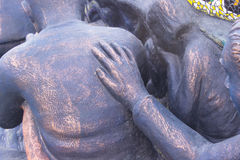 The statue`s right hand touched the back. The statue`s right hand touched the back in public Royalty Free Stock Images