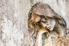 Sad woman. Statue of sad and grieved woman looking down and sustaining her reclined head with hand Stock Photography