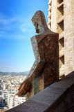 Statue at Sagrada Familia passion tower and Barcelona cityscape Royalty Free Stock Images